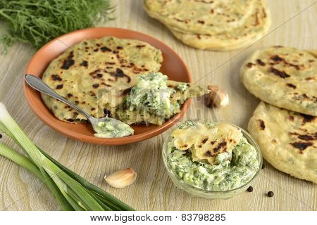 Flatbread with greens and cucumber sauce
