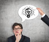image of motivation talk  - businessman thinking and hand holding bubble talk with lamp over head - JPG