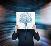picture of microchips  - young businessman holding poster with microchip tree - JPG