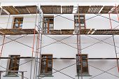 picture of reconstruction  - Plaster wall of building under reconstruction with scaffolding - JPG
