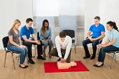 stock photo of resuscitation  - First Aid Instructor Showing Resuscitation Technique On Dummy - JPG