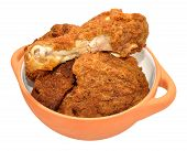 stock photo of southern fried chicken  - Cooked southern fried chicken portions in a bowl isolated on a white background  - JPG