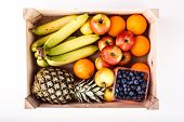 picture of crate  - Wood Crate filled with Organic ripe fruit isolated on White - JPG