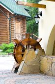foto of water-mill  - Wooden water mill as a decoration of the house - JPG