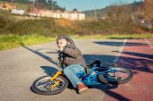 image of crying boy  - Boy crying and screaming in the street ground after falling off to his bicycle - JPG