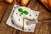 pic of baguette  - French traditional camembert cheese with baguette on wood table - JPG