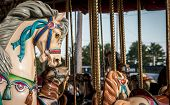 picture of merry-go-round  - Merry go around horse at a country fair in the United States - JPG