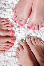 stock photo of painted toes  - Trendy colorful pedicured and gel polished toes - JPG