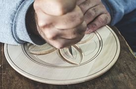 pic of woodcarving  - Woodcarver makes threaded plate - JPG