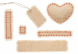 image of love hurts  - Sackcloth Heart Shape Patch Tag Label Object with Stitches Seam Burlap Isolated over White Background - JPG