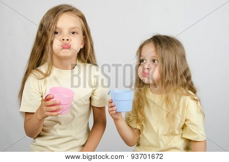 Two Sisters Rinse Your Mouth After Brushing Your Teeth