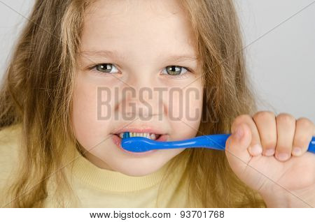 Close-up Of A Girl Cleaning Teeth