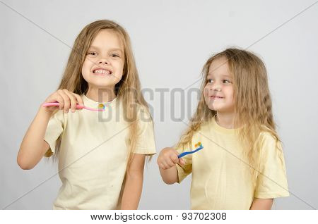 Two Sisters With Toothbrushes