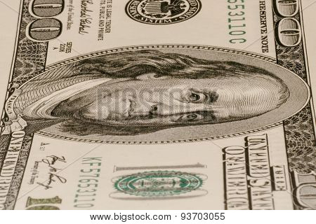One hundred dollar bill lying vertically