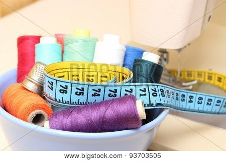 Colorful Spools Of Thread, Tape Measure And Thimble