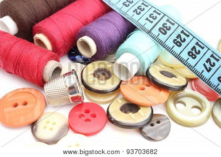 Colorful Spools Of Thread, Tape Measure, Thimble And Buttons