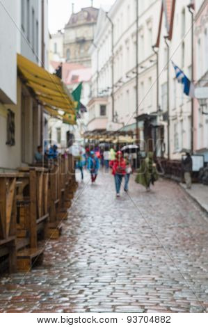 Tourists On Cobblestone Street Of Classic European Old Town, Blurred Background