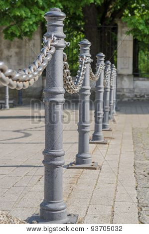 Chain Fence And Poles Closeup