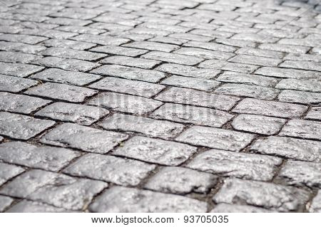 Abstract Background Of Old Cobblestone Pavement Under Sunlight