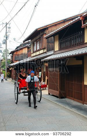 Rickshaw in Kyoto, Japan. Unidentified man with a rickshaw looks for passenger at the Kyoto Street.