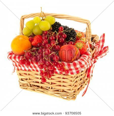 Basket full with fresh summer fruit isolated over white background