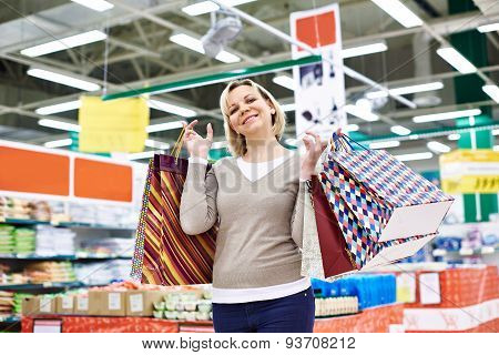 Happy Woman With Packages For Purchases