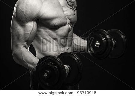 Muscular man bodybuilder with tattoos.
