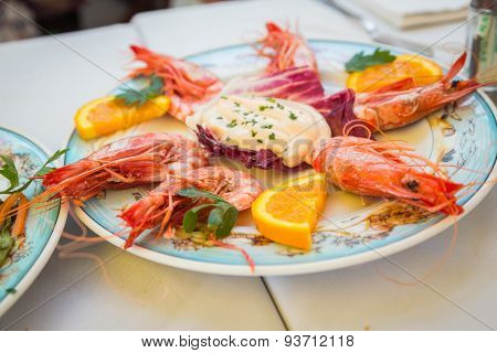 Dish with shrimp on the table in the restaurant.