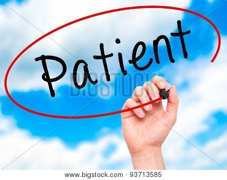 Man Hand writing Patient with black marker on visual screen.