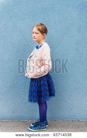 Outdoor portrait of a cute little fashion girl