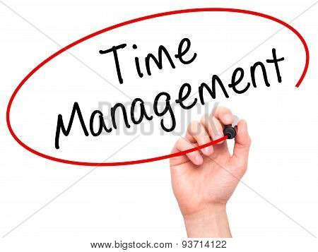 Man Hand writing Time Management with marker on transparent wipe board.