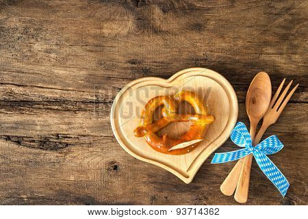 Oktoberfest festival background with pretzel on cutting board