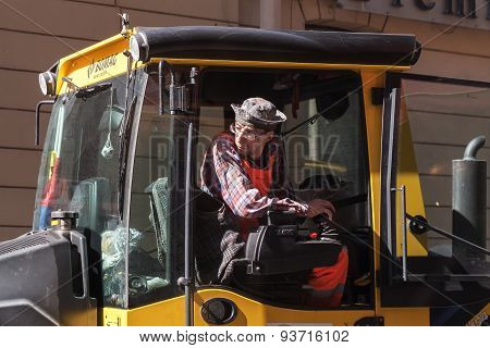 Man At Work, Industrial Steam Roller Driver In Cabin