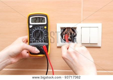 Hand Electrician Checking Voltage