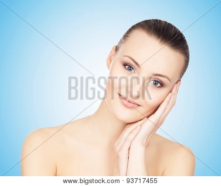 Portrait of a young woman over blue background