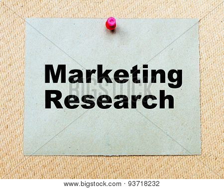 Marketing Research Written On Paper Note
