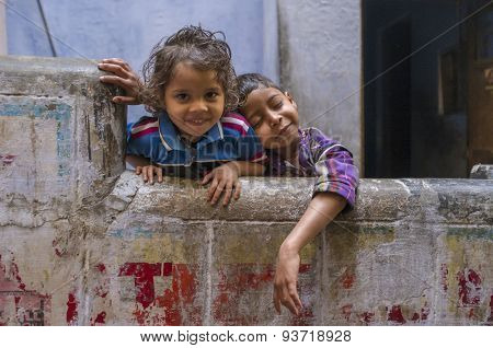VARANASI, INDIA - 20 FEBRUARY 2015: Two siblings enjoy each others company. Brother resting on sisters sholder.