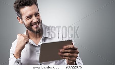 Cheerful Smiling Young Man With Tablet
