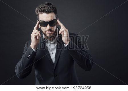 Elegant Man Adjusting Sunglasses