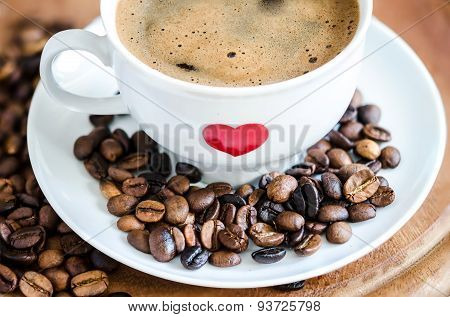 Cup of Traditional Black Coffee and Coffee Beans