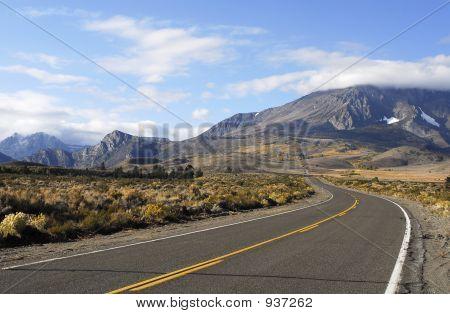 Road Leading To Autumn Mountain Scenery