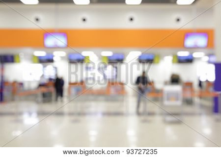 Check-in counters in airport out of focus - bokeh background