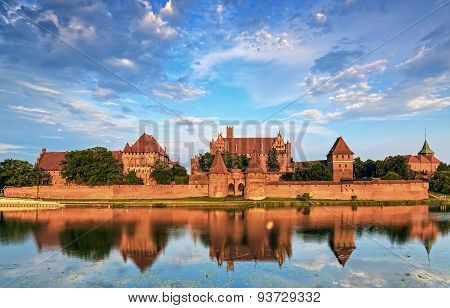 Teutonic Knights In Malbork Castle In Summer. World Heritage List Unesco.