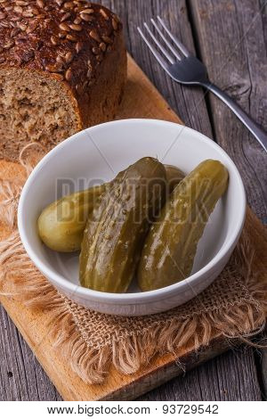 Pickled Cucumbers In White Bowl