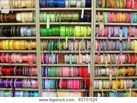Ribbon rolls at haberdashery shop