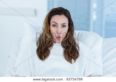 Pregnant woman on a hospital bed in hospital room