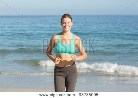 Beautiful fit woman doing jogging at the beach