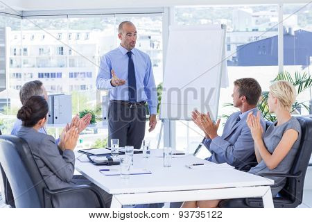 Business people applauding during meeting in the office