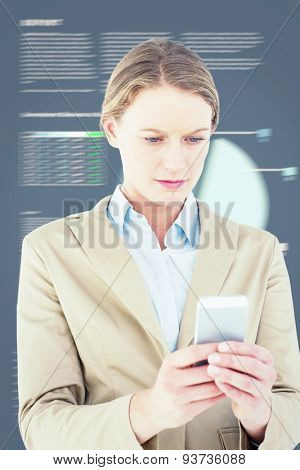Businesswoman using her mobile phone against business interface with graphs and data