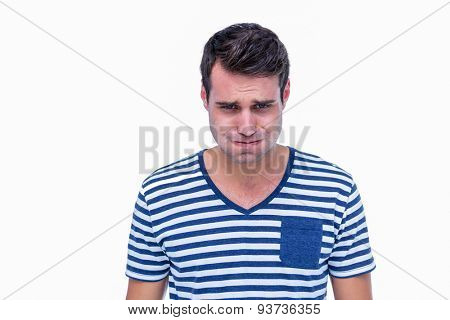 Upset hipster looking at camera on white background
